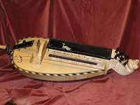 Custom Hurdy Gurdy based on a luteback Colson, decorated with a cat and mouse theme